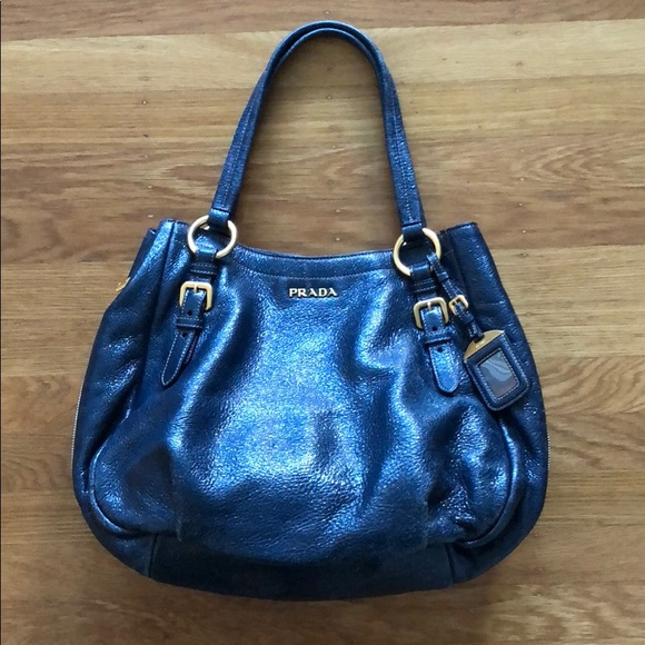 Prada navy blue purse. M 5b47f6b2dcf85501655969f5